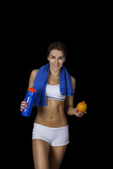 Healthy fitness girl with orange and water
