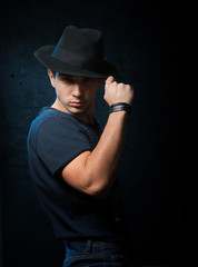 Portrait of a handsome guy with black hat