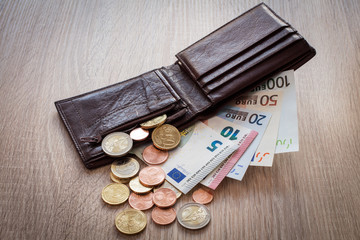 Open wallet with euro currency