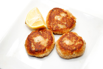 Fried Salmon Cakes with a Wedge of Lemon