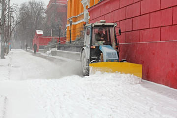 Kiev, Ukraine January 09, 2015: Tractor cleans sidewalks of snow