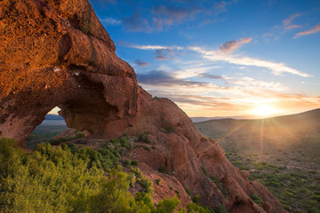 Red rock mountain arch sunset with clouds near Calitzdorp in Sou