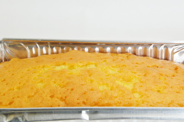 butter cake on aluminium tray close up
