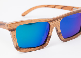 Wooden sunglasses isolated on white