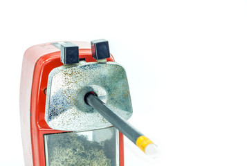 Mechanical sharpener of pencil on the white background