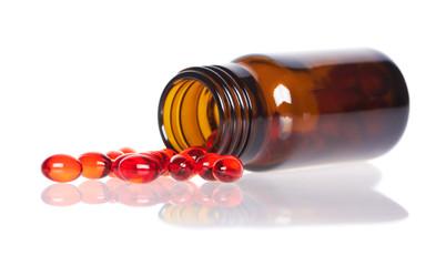 Red pills an pill bottle