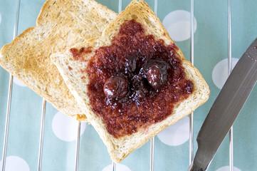 close up cherry jam on toast
