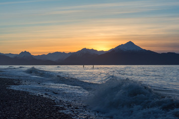 Two surfers on Kachemak Bay Alaska