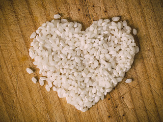 Rice heart on wooden background