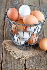 fresh farm eggs in iron basket
