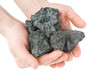 coal coke in hand on white background - 76013836