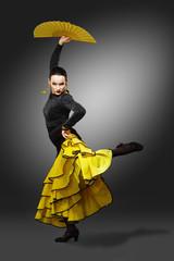 Flamenco dancer in a yellow skirt