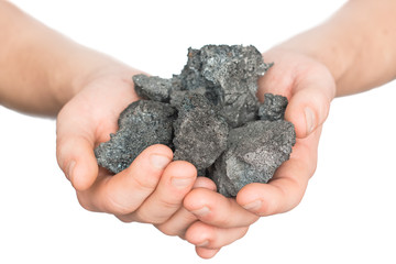 coal coke in hand on white background