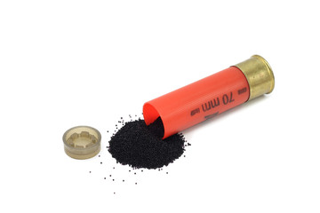 black powder spill out of the cartridge on a white background