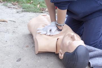 Paramedic practicing Cardiopulmonary resuscitation on a dummy