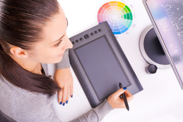 graphic designer working in office using tablet pen