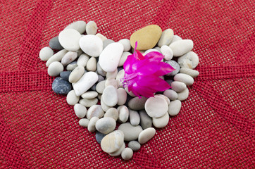 Pebble heart decorated with a pink flower