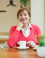 Mature woman  in   cafe.