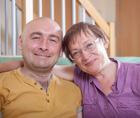 senior woman with adult son at home
