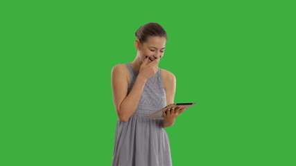 young beautiful woman uses on the tablet computer