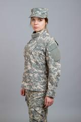 Beautiful girl in military uniform