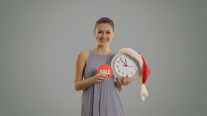 Beautiful girl shows that it is time discounts