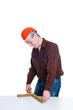 Portrait of an engineer in helmet making measurement