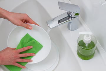 beautiful hands wash dishes
