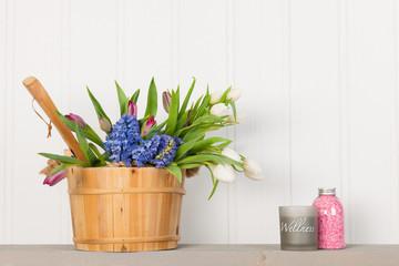 Sauna bucket with bouquet flowers
