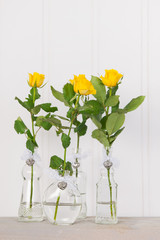 Vases with yellow roses