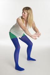 Woman in blue tights dancing a twerker dance