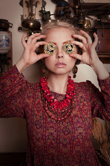 beautiful young blonde girl in retro interior in  Turkish dress