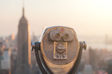 Binocular with New York Skyscrapers on Background at Sunset