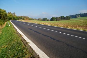 Empty asphalt road in countryside, bend of road