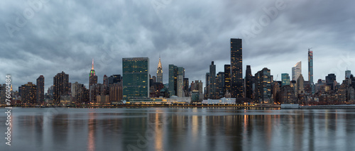 Dramatic sky over Manhattan and East River.