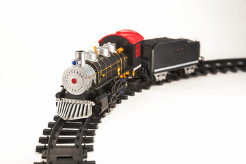Toy steam locomotive on rails