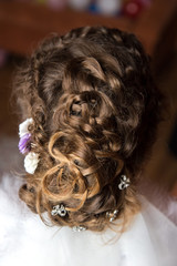 The wedding hairdress of the bride