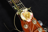 Acoustic guitar and wilted rose flower poster