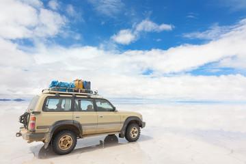 Car on the Uyuni Salar in Bolivia
