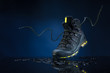 mountain boots on a dark background - 76022299