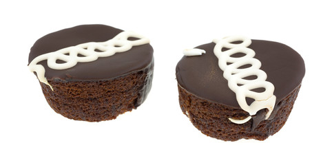 Two chocolate iced cakes on a white background