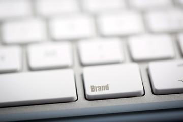 """The word """"BRAND"""" written on keyboard."""