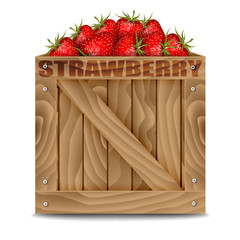 Strawberries in wooden box isolated on white