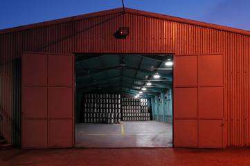 big brewery warehouse beer deposit in the night