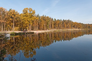 Forest lake bank, autumn, water reflection, people, rest, beach