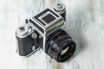 Old medium format camera on wooden table