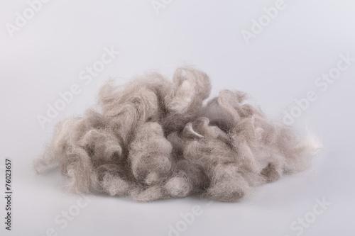 Raw wool yarn coiled into a ball - 76023657