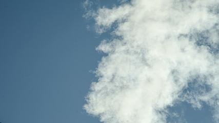 White smoke against a blue sky