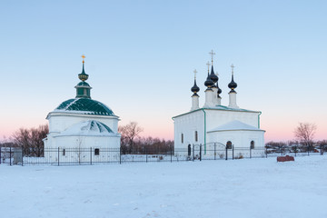 Winter landscape in frosty morning with old orthodox church