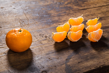 group of tangerine's slices on wooden background